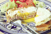 Croque madame horizontal with salad — Stock Photo