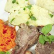 Lamb chops carrots and baked potato vertical — Stock Photo #7564274
