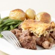 Steak and kidney pie with fork - Stock Photo