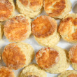 Fresh baked English scones from above - Stock Photo