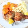 Lemon chicken meal on plate — Stock Photo