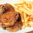 Roast chicken thighs and fries high angle - Foto Stock
