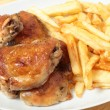 Roast chicken thighs and fries high angle - Zdjcie stockowe