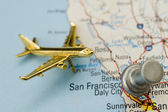 Plane and Thumbtack Over California — Stock Photo