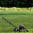 Lawn Mower in Back Yard — Stock Photo