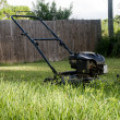 Stock Photo: Lawn Mower on Grass