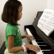 Kid playing piano — Stock Photo #7801328