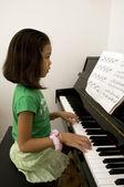 Kid playing piano — Stock Photo