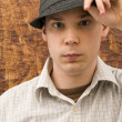 Stock Photo: Young mand his hat