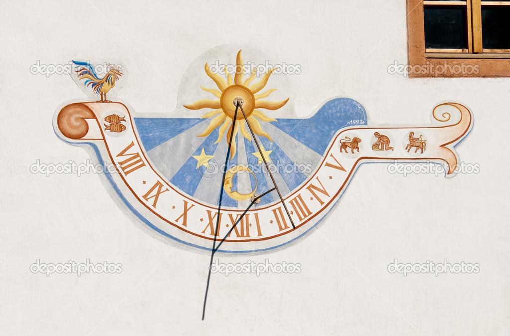 Colorful sundial painted on a white wall  Stock Photo #7592377