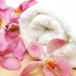 Clean towel and orchid — Stock Photo