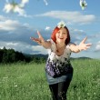 Young woman throwing daisies — Stock Photo #7109033