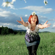 Stock Photo: Young womthrowing daisies
