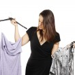 Young brunette deciding what to wear — Stock Photo