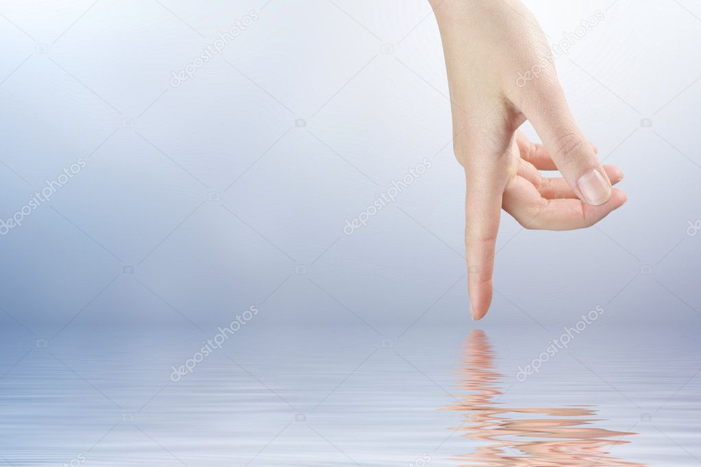 Female finger touching the water surface level — Stock Photo #7109160