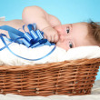 Stock Photo: Adorable baby in wicker basket