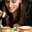 Stock Photo: Woman pouring herself a cup of tea