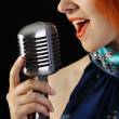 Retro redhead female singer — Stock Photo
