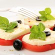 Served tomato with mozzarella and basil - Stock Photo