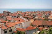Roof tops in little town by the sea — Stock Photo