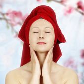 Young woman with red towel — Stock Photo