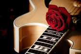 Red rose and jazz guitar — Stock Photo