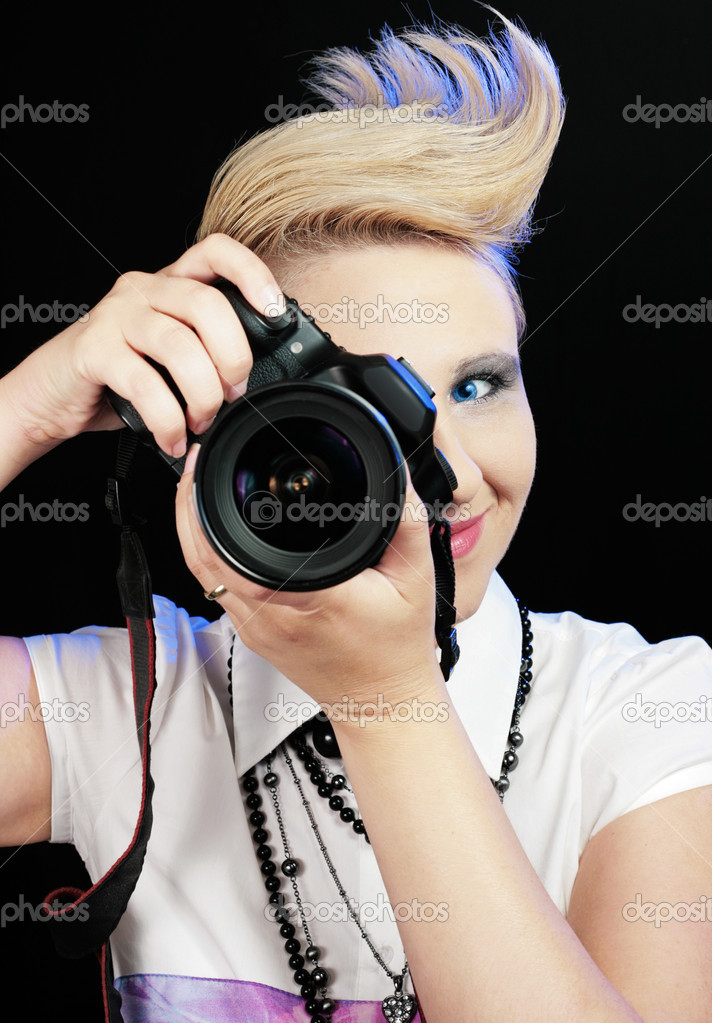 Woman with camera, taking a photo — Stock Photo #7371147