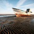 Aground boat on beach — Stock Photo #7472874