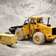 Buldozer in quarry - Stock Photo