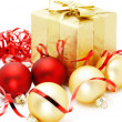 Golden box with christmas baubles - Stock Photo