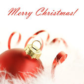 Red bauble and ribbon — Stock Photo
