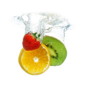 Fruit dropped in the water — Stock Photo