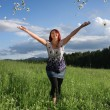Stock Photo: Woman throwing daisies