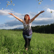 Stock Photo: Womthrowing daisies
