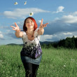 Woman throwing daisies — Stock Photo