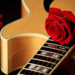 Rose on jazz guitar — Stock Photo