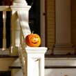 Halloween Pumpkin on White Guardrail — Stock Photo #7105103