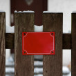 Empty Red Sign on Fence in Snowy Winter Copyspace — Stock Photo