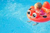 Baby Floatee Look Away — Stock Photo