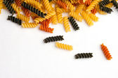 Multicolored Curly Pasta Spill — Stock Photo