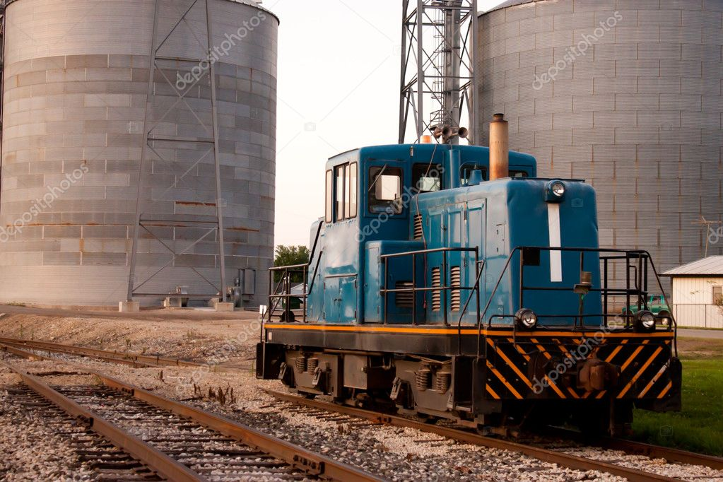 Train head car stopped on tracks in front of grain mill — Stock Photo #7105228