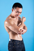 Fit man suffering from painful elbow injury — Stock Photo