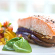 Baked salmon on bed of grill aubergine — Stock Photo #7110114