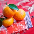 Mandarin oranges with Chinese new year money packet — Stock Photo #7111094