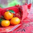 Mandarin oranges with Chinese new year money packet — Stock Photo #7111143