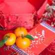 Mandarin oranges with Chinese new year money packet — Stock Photo #7111199