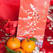 Stock Photo: Mandarin oranges with Chinese new year money packet