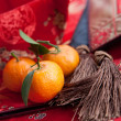 Mandarin oranges with Chinese new year money packet — Stock Photo #7111342