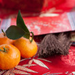 Mandarin oranges with Chinese new year money packet — Stock Photo #7111372