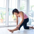 Asian woman doing stretching exercise — Stock Photo